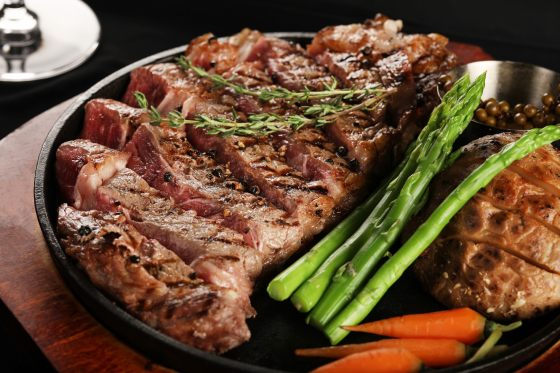 Red Meat on a Tray with Vegetables