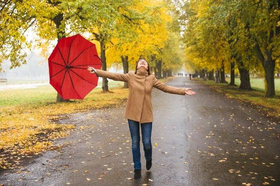 Woman Dancing in Rain with Optimal Health